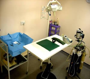 Theatre and operating table and lights with green drapes Bramcote Surgery Derby