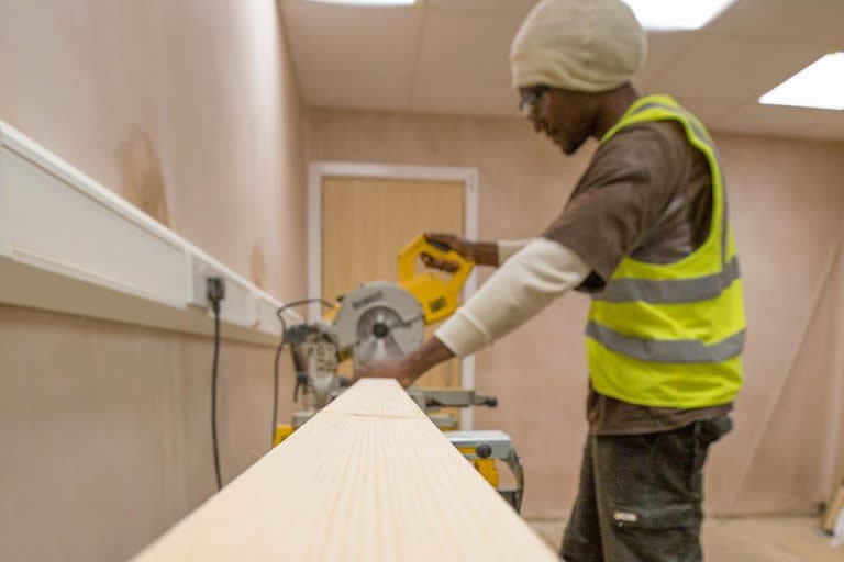 Long Eaton Ashfield House new vet hospital carpenter sawing wood in the building