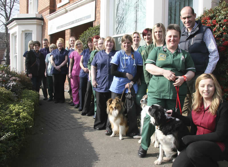 Staff and pets Ashfield House Vets outside surgery in Derby Road Long Eaton